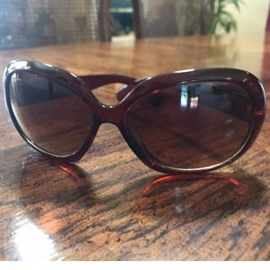 Beautiful dark frame Brown sunglasses.